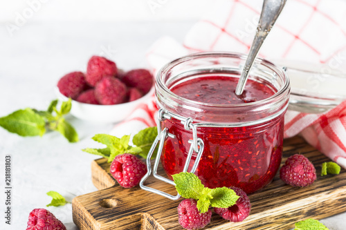 Strawberry jam in glass jar. Wallpaper Mural