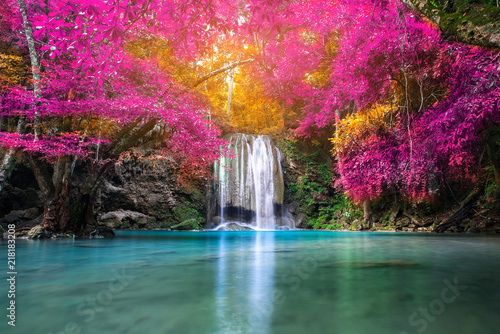 Fotobehang Watervallen Amazing beauty of nature, waterfall at colorful autumn forest