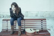 Pensive Female Street Guitar P...