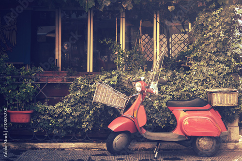 Tuinposter Scooter retro scooter in italy, traditional style motorcycle with foliage background (image with vintage effect)