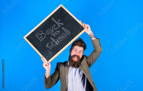 Teacher with tousled hair cheerful about school year beginning Fototapet