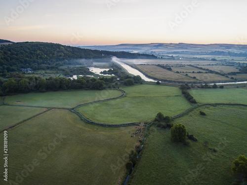 Spoed Foto op Canvas Khaki Drone image of a misty dawn English landscape