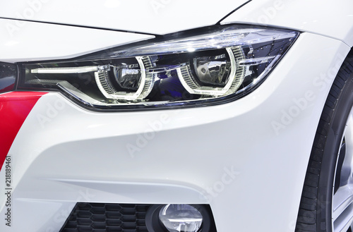 Fototapeta Close up detail on one of the LED headlights modern car. obraz na płótnie
