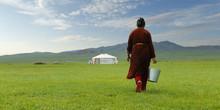 Mongolian Farmer Carrying Buck...