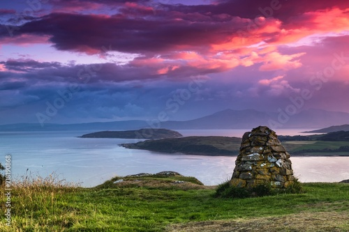 Foto Colourful sunset looking over the Cumbrae Isles towards Arran, on the West coast of Scotland