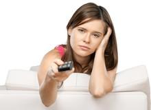 Bored Woman Using Remote Control