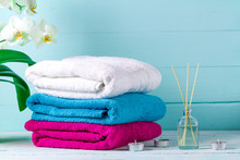 Towels On A Blue Background. Hygiene. Shower. Aroma Therapy