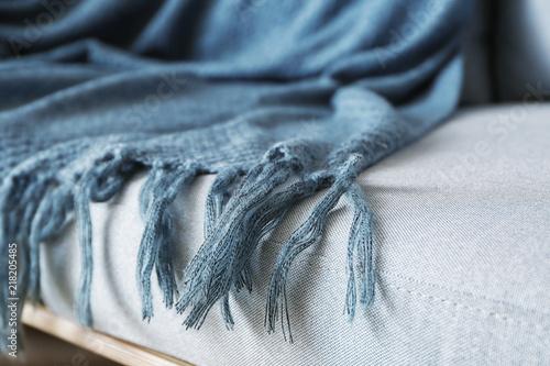 Warm plaid on sofa, closeup