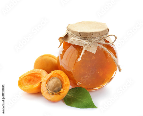 Jar with sweet apricot jam and fresh fruit on white background Wall mural