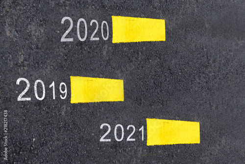 Poster  Number of 2019 to 2021 on asphalt road surface with marking lines, happy new yea