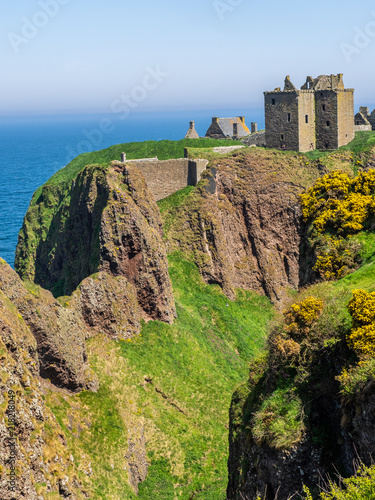 The reamins of the medieval fortress, Dunnottar Castle, located upon a rocky hea Canvas Print