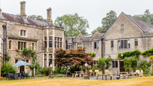 Traditional Old Manor House On The Countryside Of In Wales, UK