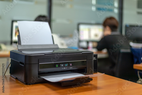 Cuadros en Lienzo black printer in office with soft-focus and over light in the background