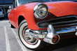 A view of a classic vintage American car in a parking lot