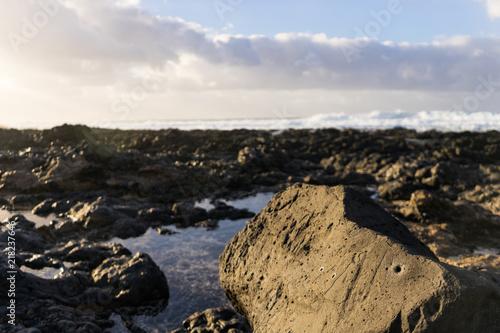 In de dag Canarische Eilanden Sun shining on black volcanic rock beach on Lanzarote Island
