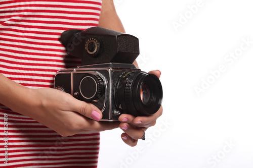 Fototapeta Women's hands with an old camera. obraz na płótnie