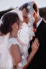 A Tender Kiss Of Wedding Coupl...