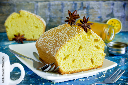 Fototapeta Sfuf - middle eastern turmeric cake. Oriental spicy yellow cake with curcuma, sesame and star anise obraz
