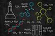 Handwritten chalk chemical formulas, DNA code, chemical flasks on school blackboard. Back to school background.