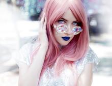 Young Woman Wearing Kaleidoscope Sunglasses Outdoors