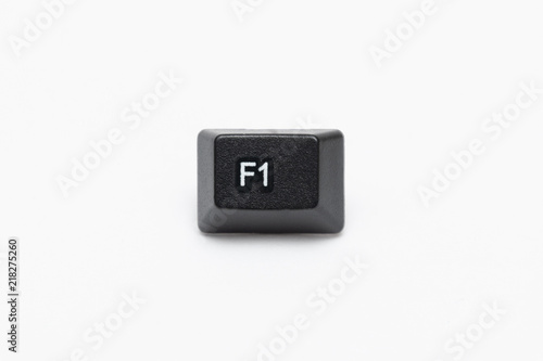Fotobehang F1 Single black keys of keyboard with different letters F1