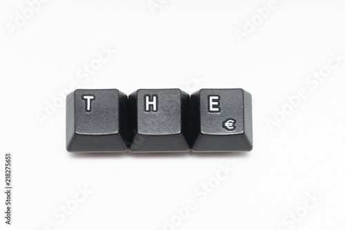 Photo  Single black keys of keyboard with different letters THE