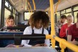 Woman using mobile phone while travelling in modern bus