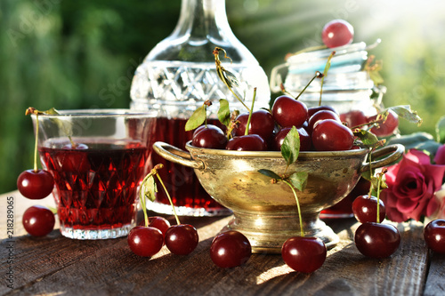 cherry liqueur in crystal carafe and fresh fruits Canvas Print