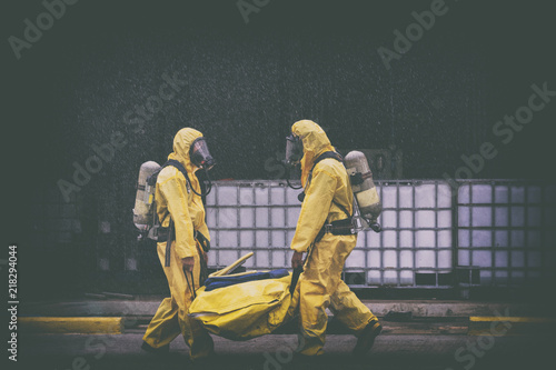 Fotografija  chemical spill pollution response team in action recovery stop spill of the chemical spill pollution at factory