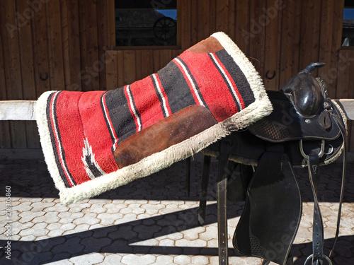 Fotografía  Colored horse saddle in a farm