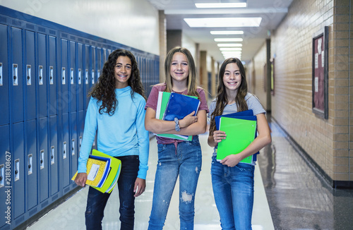 Group of Junior High school Students standing together in a school hallway Canvas Print