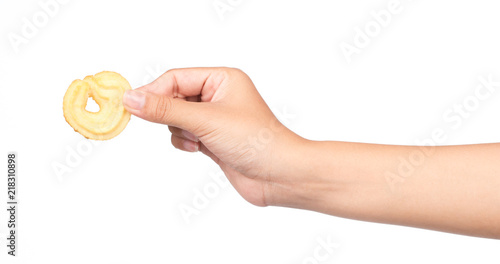 Photo  hand holding cookie isolated on white background