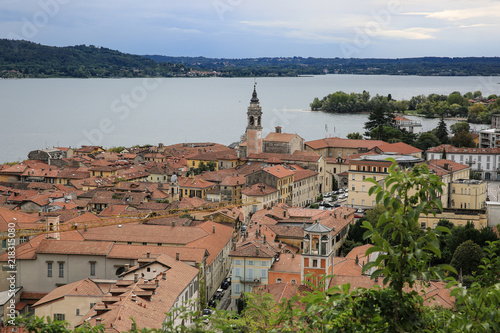 View at Arona and Lake Maggiore, Italy, medieval city, cathedral, blue sky with Canvas Print