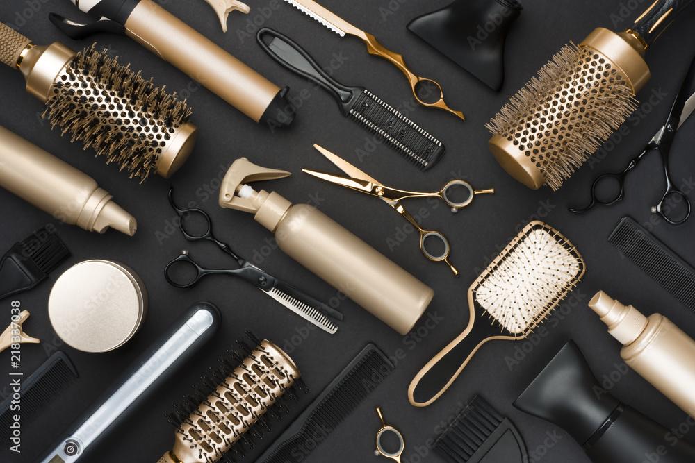 Fototapeta Full frame of professional hair dresser tools on black background