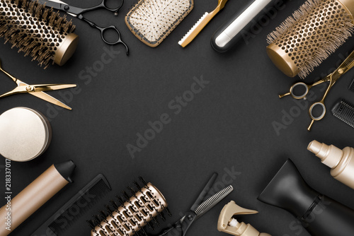 Obraz Hairdresser tools on black background with copy space in center - fototapety do salonu