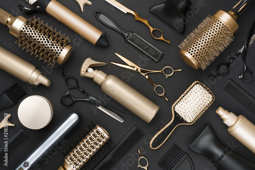 Obraz Full frame of professional hair dresser tools on black background - fototapety do salonu
