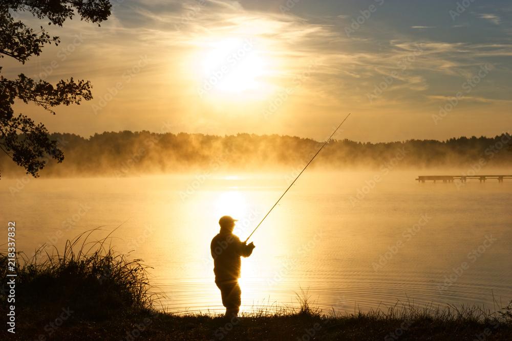 Fototapety, obrazy: Silhouette of fisherman during foggy sunrise
