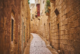 Fototapeta Uliczki - Narrow stone street in old Mdina city, Malta