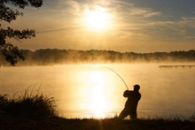 Silhouette Of Fisherman During...