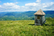 Abandoned Wooden Shed, Small House, On A Green Meadow, Blue Horizon, Mountains, Ukraine