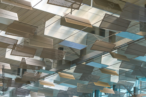 Modern layered panel geometric shape ceiling with adjustable external natural light system in the decoration for energy saving and environmental