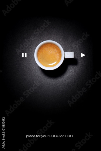 Coffee Poster Advertisement. Coffee cup on black table. Top view with copyspace for your text