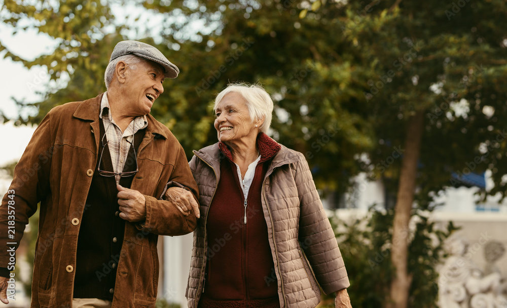 Fototapeta Loving senior couple enjoy a walk together on a winter day