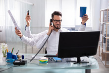Young Businessman Doing Multitasking Work
