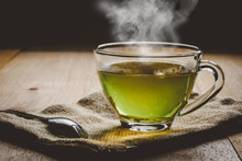 Close-up A Cup Of Green Tea On Sackcloth, Hot Drink With Steam