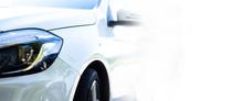 Modern White Car Front & Headlights (copyspace)
