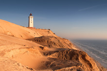 Aerial View Of The Giant Sand Dunes With The Famous Lighthouse On The Top Of A Hill. Rubjerg Knude Lighthouse, Lønstrup In North Jutland In Denmark, Skagerrak, North Sea