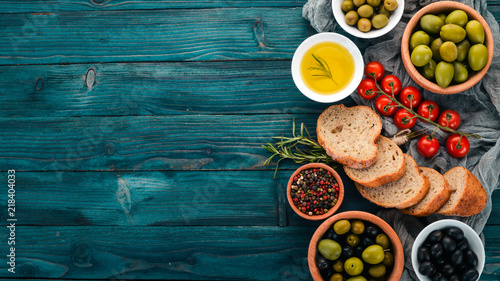A set of green olives and black olives, and snacks Fototapeta