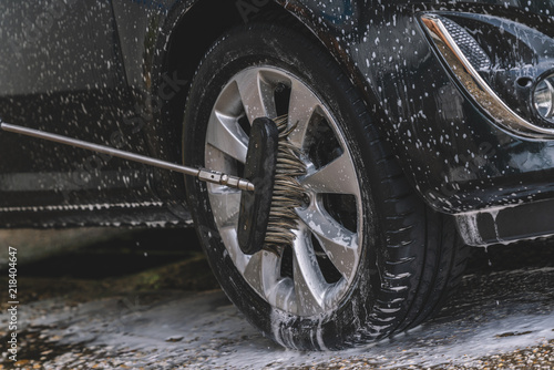 Car washing with soap and brush Canvas Print