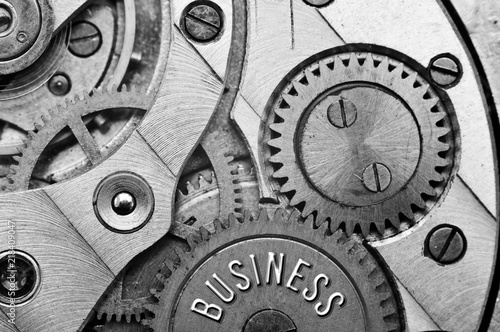 Poster Spirale Background with the inscription BUSINESS. Black white background with metal cogwheels clockwork. Macro.
